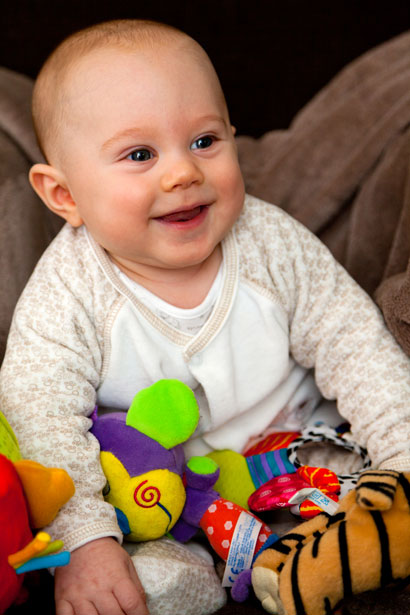 smiling baby with toys as a daisy and Betty (Gay